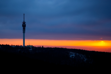 tv tower: TV tower on top of the hill at cloudy sunrise Stock Photo