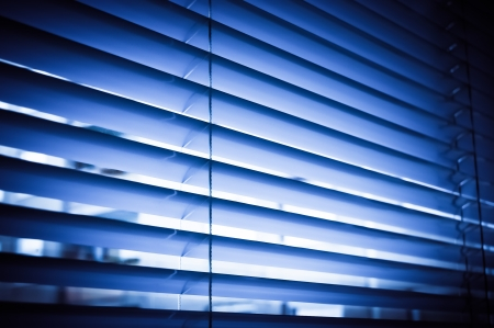 Blue venetian blinds in the office