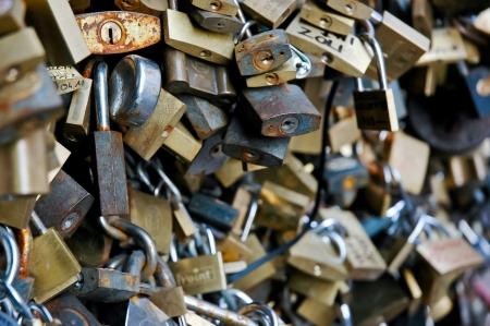 Love padlocks hanging on the fence