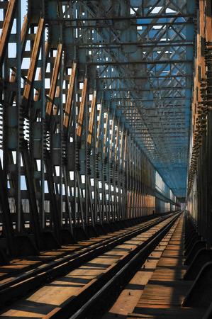 Old rusty metal railway bridge