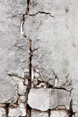 Cracked old ruined brick wall