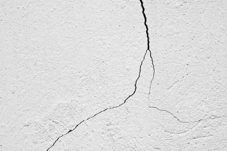 Cracked old white washed wall