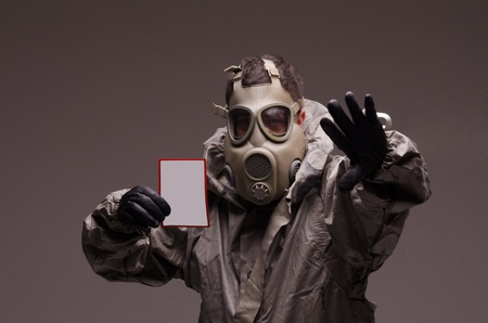 Man with a gas mask in a studio photo