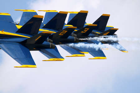 airshow planes flying in tight formation