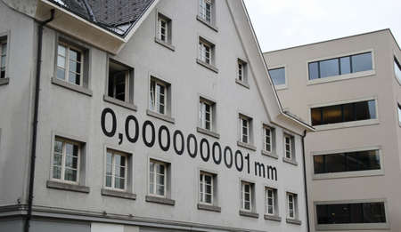0,0000000001 mm nanometer unit on the facade of a traditional house in Bregenz, Austria