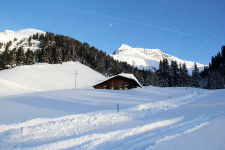 Winter Chalet House at the Mountains in Lech am Arlberg with Road, Austrian Alps