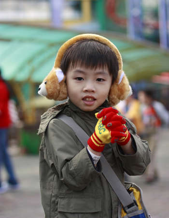 ear muffs: Smiling kid with ear muffs 1 Stock Photo