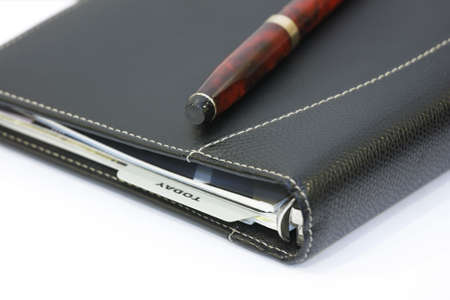 Diary planer with ball pen photo