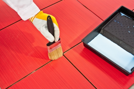 brush primer grout of red tiles resistant Stock Photo - 14696064