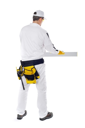 construction worker in white coveralls smooth wall level nivel tool in back