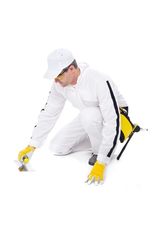 construction worker in white coveralls trowel floor white background Stock Photo