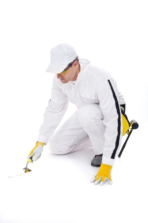 construction worker in white coveralls trowel tools on white background