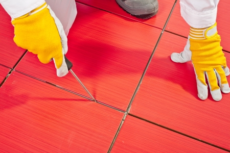 Sharp tool clean spaces between tiles remove tile adhesive debris dust particles
