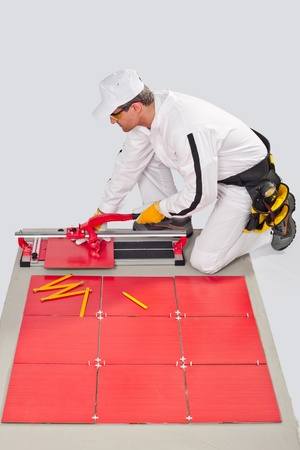 worker cut ceramic tile machine tiling joint crosses Stock Photo - 14711172