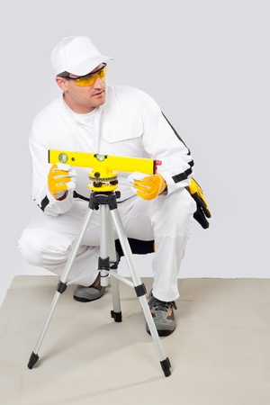worker level measured with a laser level photo