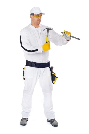 Workers in white overalls working with yellow hammer and chisel on a white background