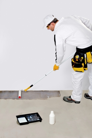 Worker Paint with Primer Concrete Floor for Waterproofing