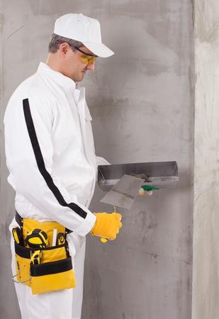 putty: Worker preparing a putty
