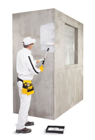 priming: Worker priming with a paint roller Stock Photo