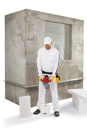 Worker mixing an insulation adhesive Stock Photo