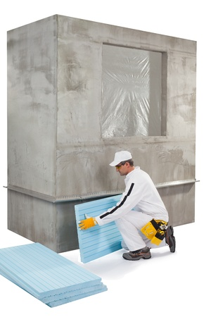 Worker setting up an insulation panel photo