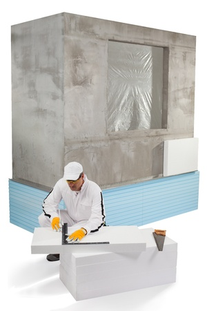 gypsum: Worker measuring an insulation panel Stock Photo