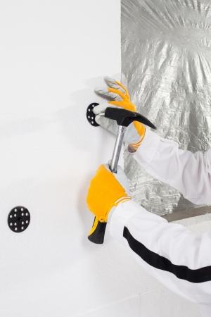 dowel: Worker fixing a dowel