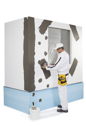 Worker reinforcing a window frame Stock Photo