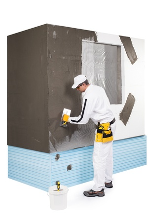 Worker spreading a putty Stock Photo