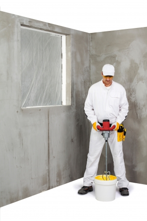 gypsum: Worker mixing a plaster with a stirrer machine Stock Photo