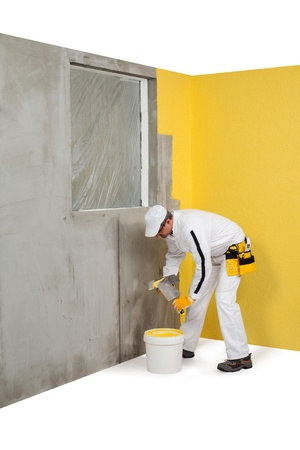 Worker getting a plaster from a pail