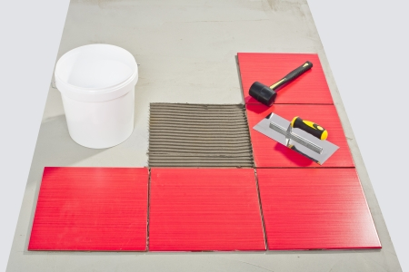 ceramic tilles and tile adhesive on floor Stock Photo