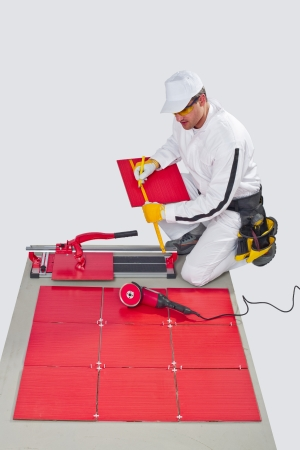 construction worker cutting ceramic tiles Stock Photo