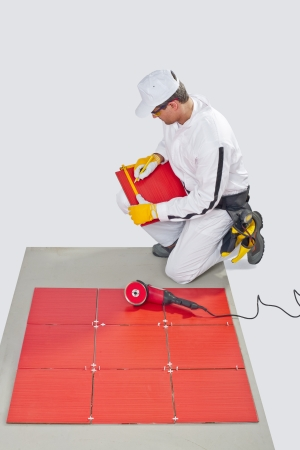 construction worker glued ceramic tile floor photo