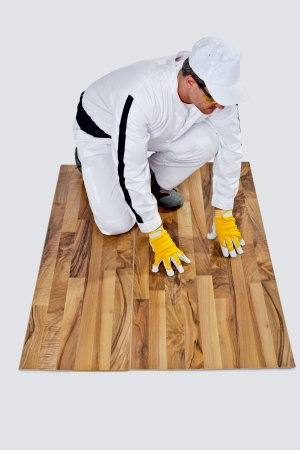 construction worker checks a wooden floor