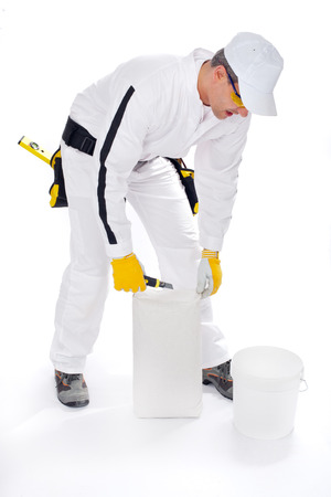 construction worker with bucket and tile adhesive
