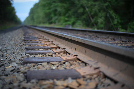 train tracks disappearing in the distance Stock Photo