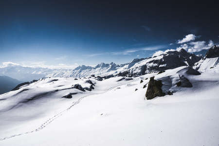 whiteness: A sunny day on snowshoes in the Swiss Alps