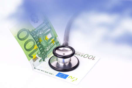 a hundred Euro bank note with a stethoscope.