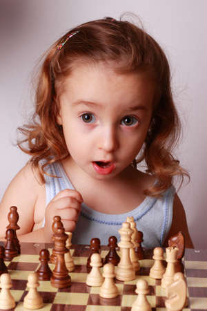 a child and a chessboard photo