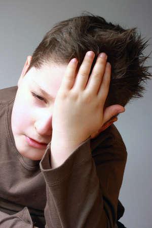portrait of headache the boy's small