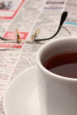 Searching job with newspaper and tea photo