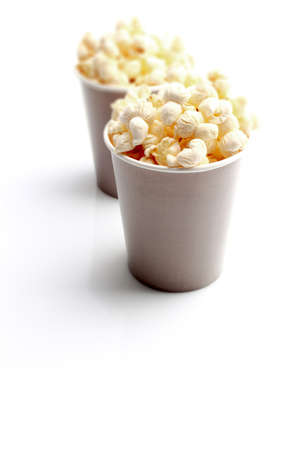 bowls of popcorn: Brown tall bowl with popcorn isolated on white