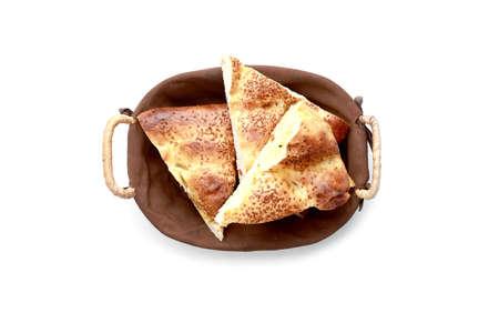 pita bread: Slice pita bread in a basket on a white background.