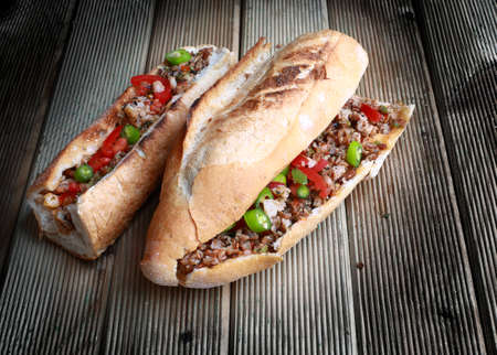The cooked kokoretsi is chopped or sliced, sprinkled with oregano, and served on a plate. It may also (especially in Turkey) be served in half a baguette or in a sandwich bun, plain or garnished, almost always with oregano and red pepper.