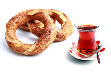 Fresh Turkish bagel and tea on a white background