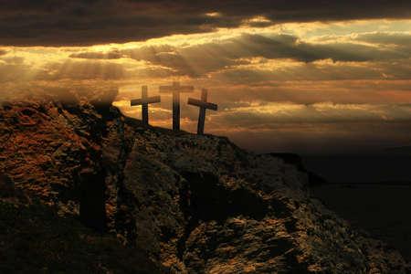 Easter sunrise and Three crosses on a hill. Standard-Bild
