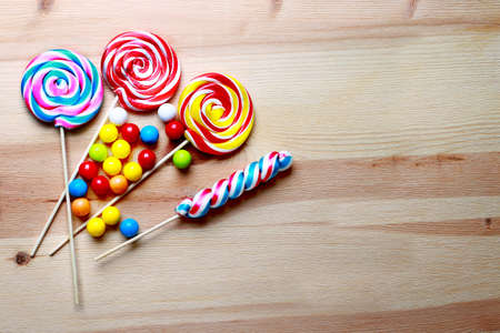 Colorful lollipops and different colored round candy. Top view.