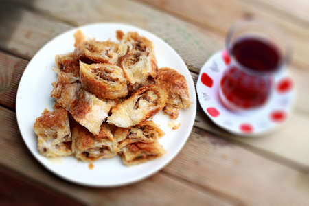 Arm boregi (Arm borek) is a Turkish puff pastry prepared in long rolls, traditionally filled with cheese, potatoes, spinach, or meat, and baked at a low temperature.  Stock Photo