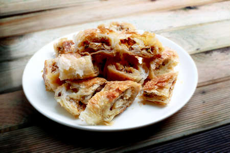 Arm boregi (Arm borek) is a Turkish puff pastry prepared in long rolls, traditionally filled with cheese, potatoes, spinach, or meat, and baked at a low temperature.